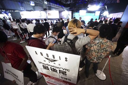 Visitors queue up to play new games at the Tokyo Game Show in Chiba, near Tokyo, Thursday, Sept. 21, 2017. The Japanese video game industry is back, after suffering years of the doldrums, with decades-old titles being adapted for revamped technology. That energy was amply evident at the Tokyo Game Show, an annual event showcasing video games.