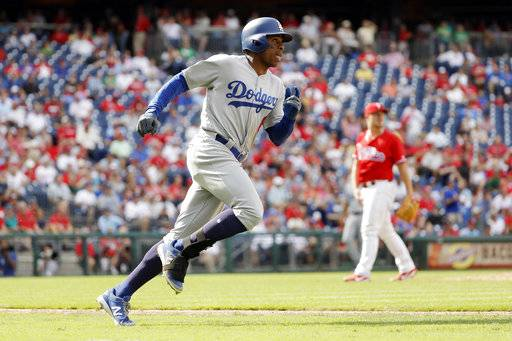Los Angeles Dodgers' Curtis Granderson, left, rounds the bases after hitting a home run off Philadelphia Phillies pitcher Mark Leiter Jr. during the sixth inning of a baseball game, Thursday, Sept. 21, 2017, in Philadelphia. Los Angeles 5-4.