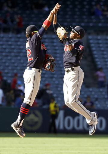 Cleveland Indians shortstop Francisco Lindor, left, celebrates with center fielder Greg Allen after the teams win against the Los Angeles Angels during a baseball game in Anaheim, Calif., Thursday, Sept. 21, 2017.