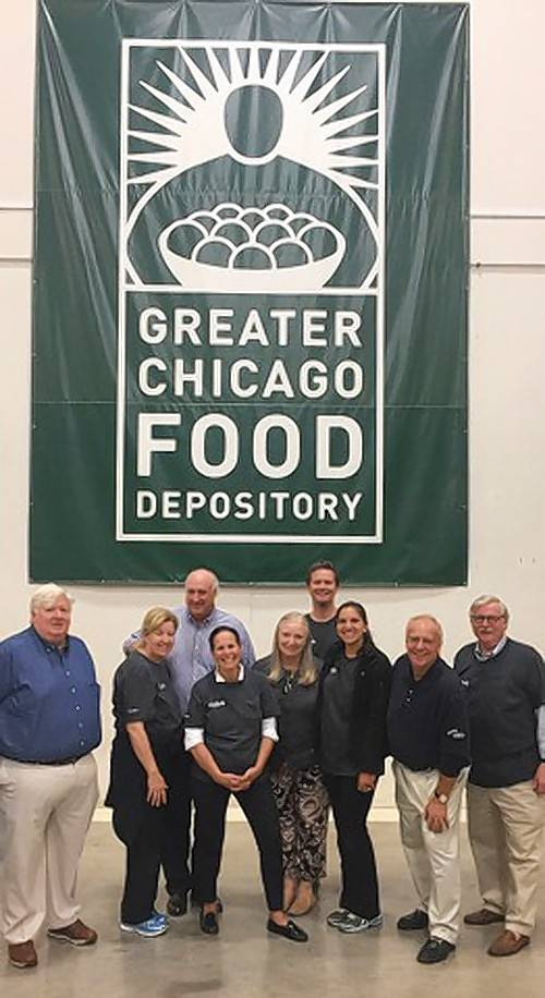 The Buddig family volunteers at The Greater Chicago Food Depository to sort and re-pack food for distribution. (Photo: Business Wire)