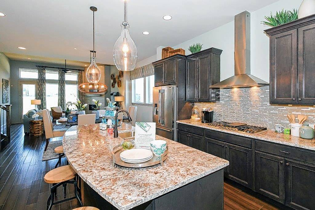 The Moongate model home at The Reserve at Barrington offers a first-floor study, flex space upstairs and a huge kitchen island, features desired by Gen X buyers.