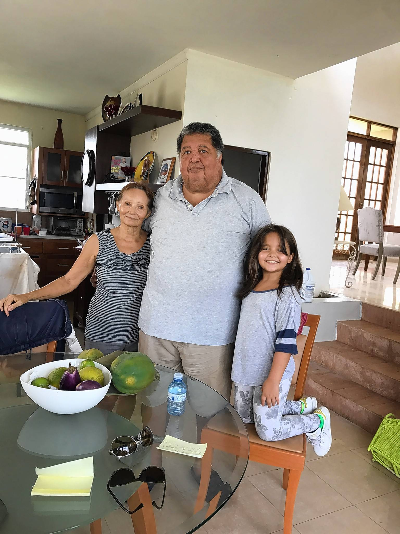 Ivelisse Robles Lynch of Cary received this photo of her parents in Puerto Rico, Elvyn Robles and Carmita Feliciano Robles, and their granddaughter Adriana Stella, on Friday afternoon -- a huge relief after two days of uncertainty.