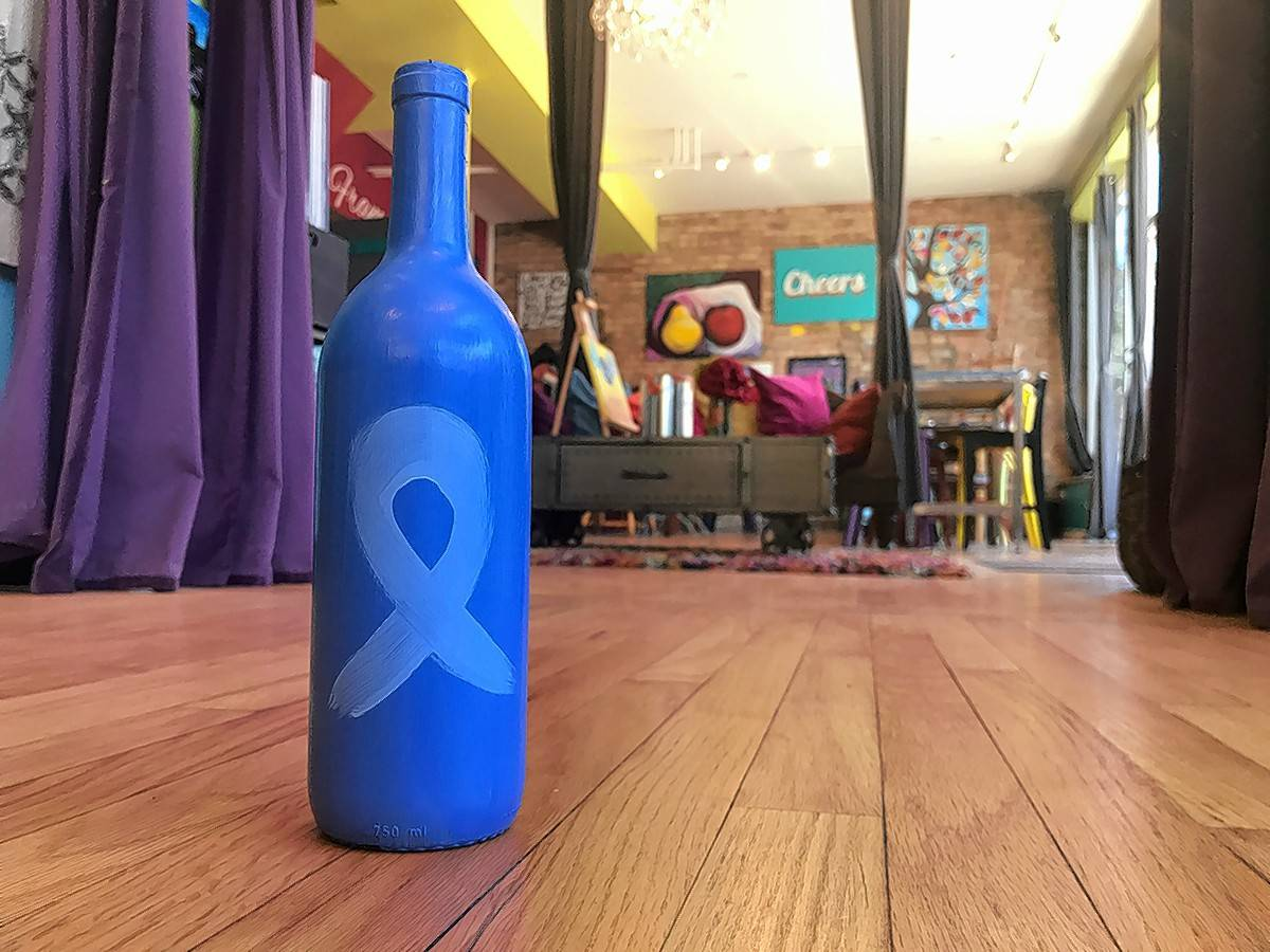 Bottle & Bottega in Arlington Heights will host a nude male model painting event Friday night. Guests can also bring in an empty wine bottle and paint it light blue to support the Prostate Cancer Foundation.