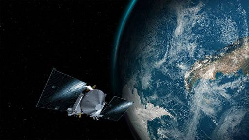 This illustration provided by NASA depicts the OSIRIS-REx spacecraft and the Earth. On Friday, Sept. 22, 2017, the probe will use Earth's gravity to put it on a path toward the asteroid Bennu. (Conceptual Image Lab/Goddard Space Flight Center/NASA via AP)