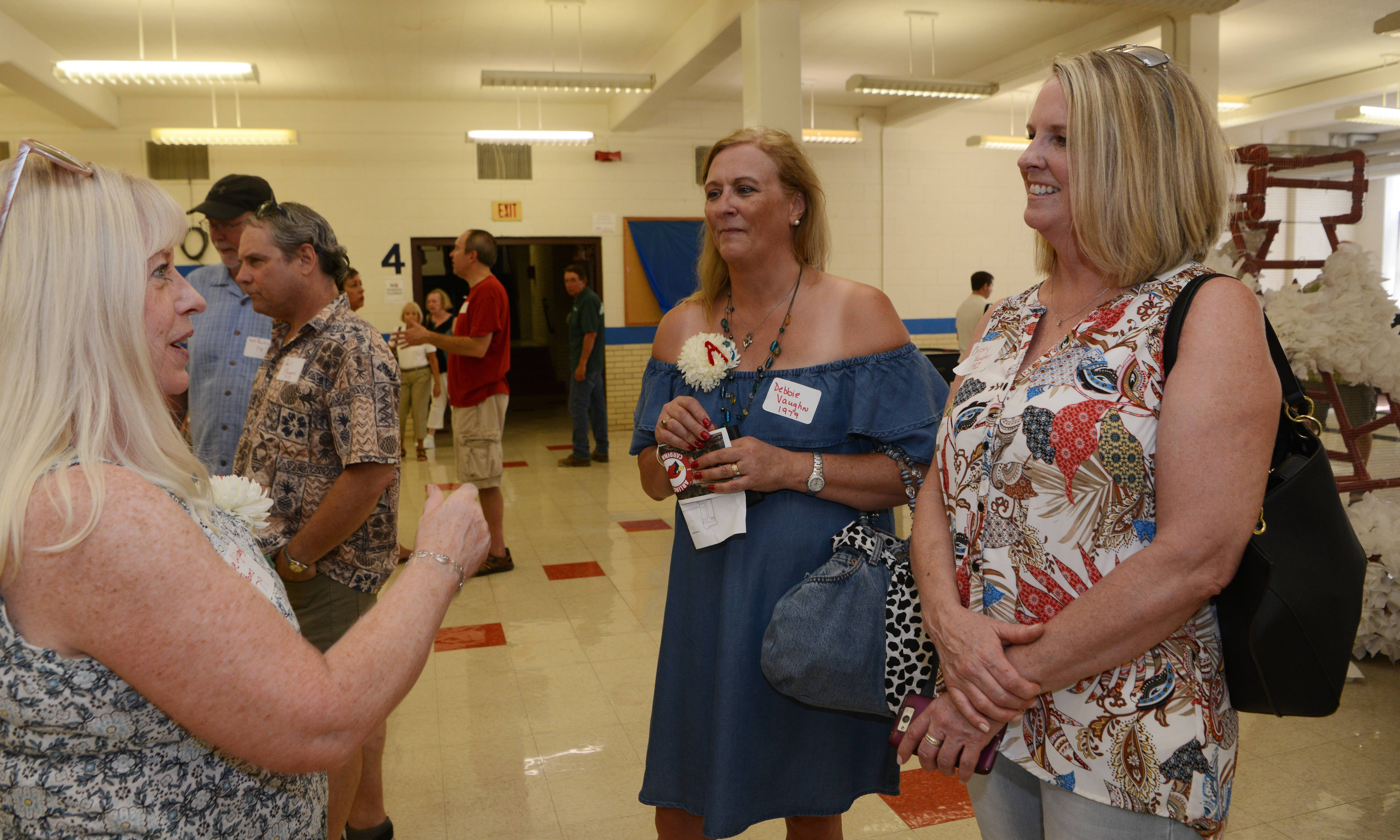 Sue Liljeberg Thoms of the class of 1979 chats with Debbie Vaughan '79 and her sister, Christy Vaughan '82 during the Arlington High School all-class homecoming, held at the former school building, which is now Christian Liberty Academy, in Arlington Heights Saturday.