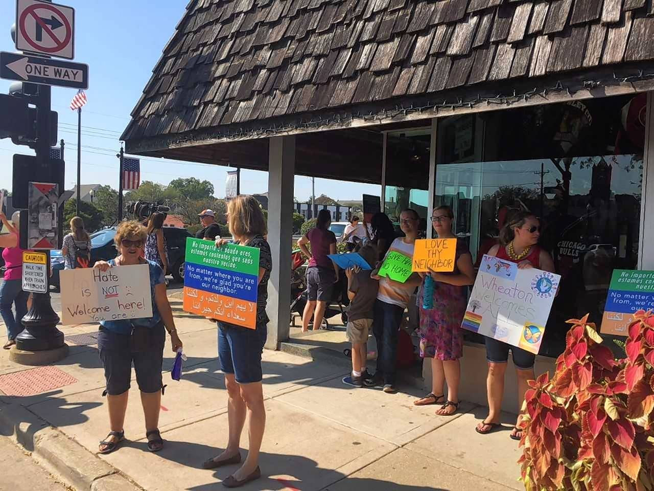More than 100 people protest Wheaton landlord over 'back to Vietnam' sign