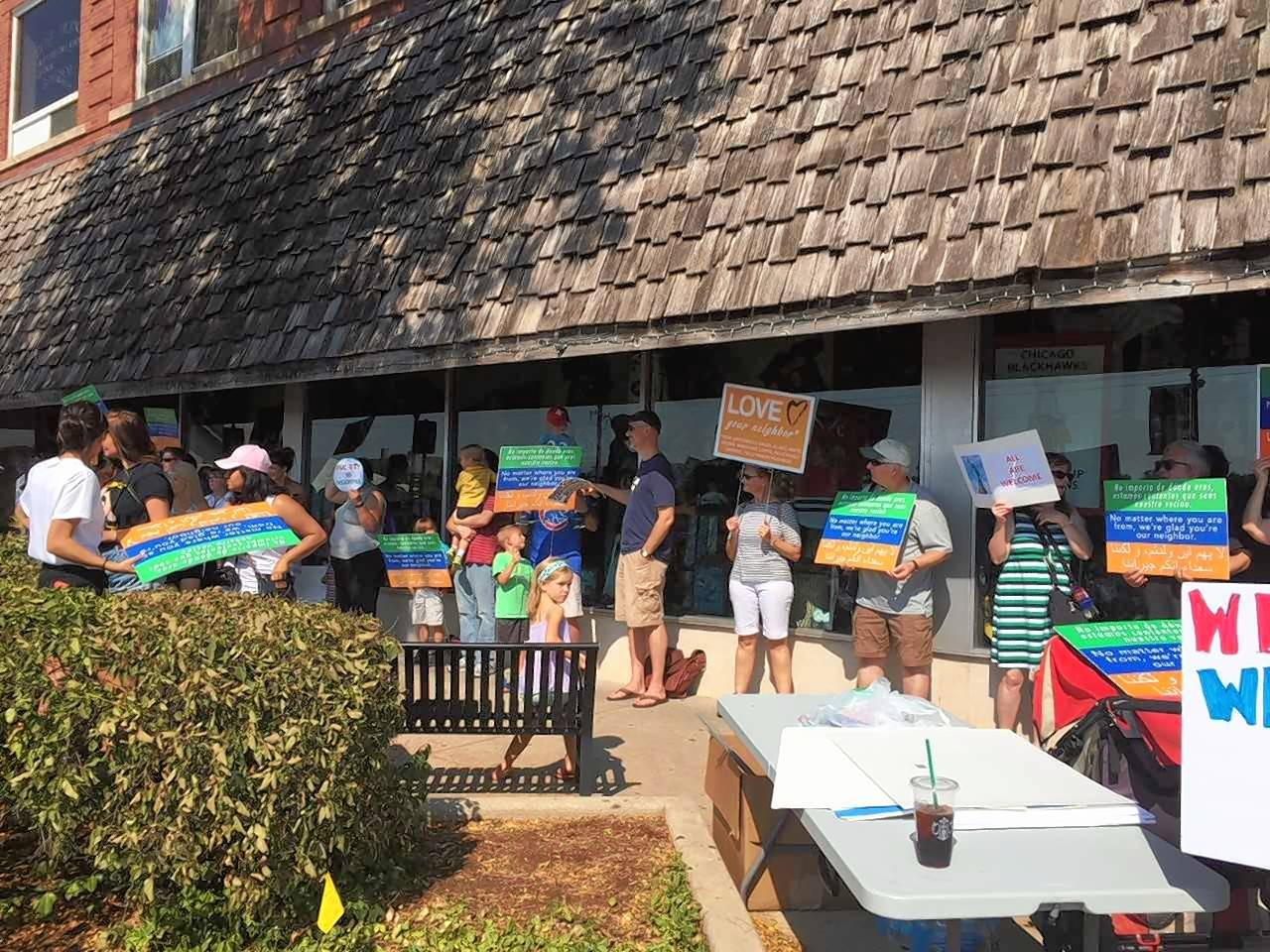 More than 100 protesters wrapped themselves around the building at 101 W. Front Street to support diversity in Wheaton.