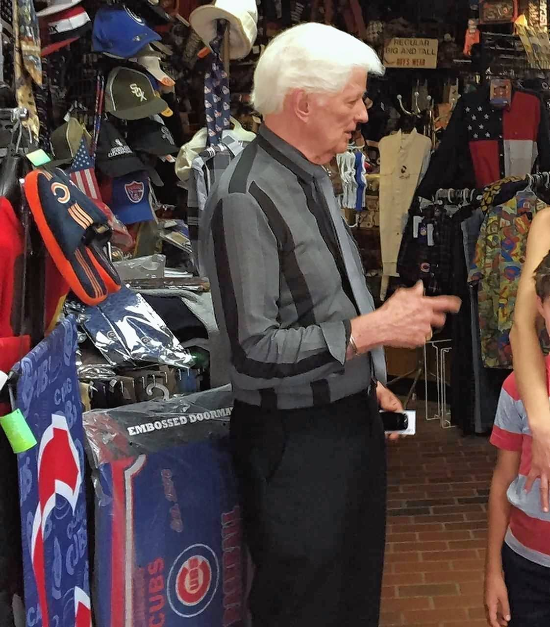 Robert Sandberg talks with customers Saturday inside his store at the corner of Main and Front streets in Wheaton.