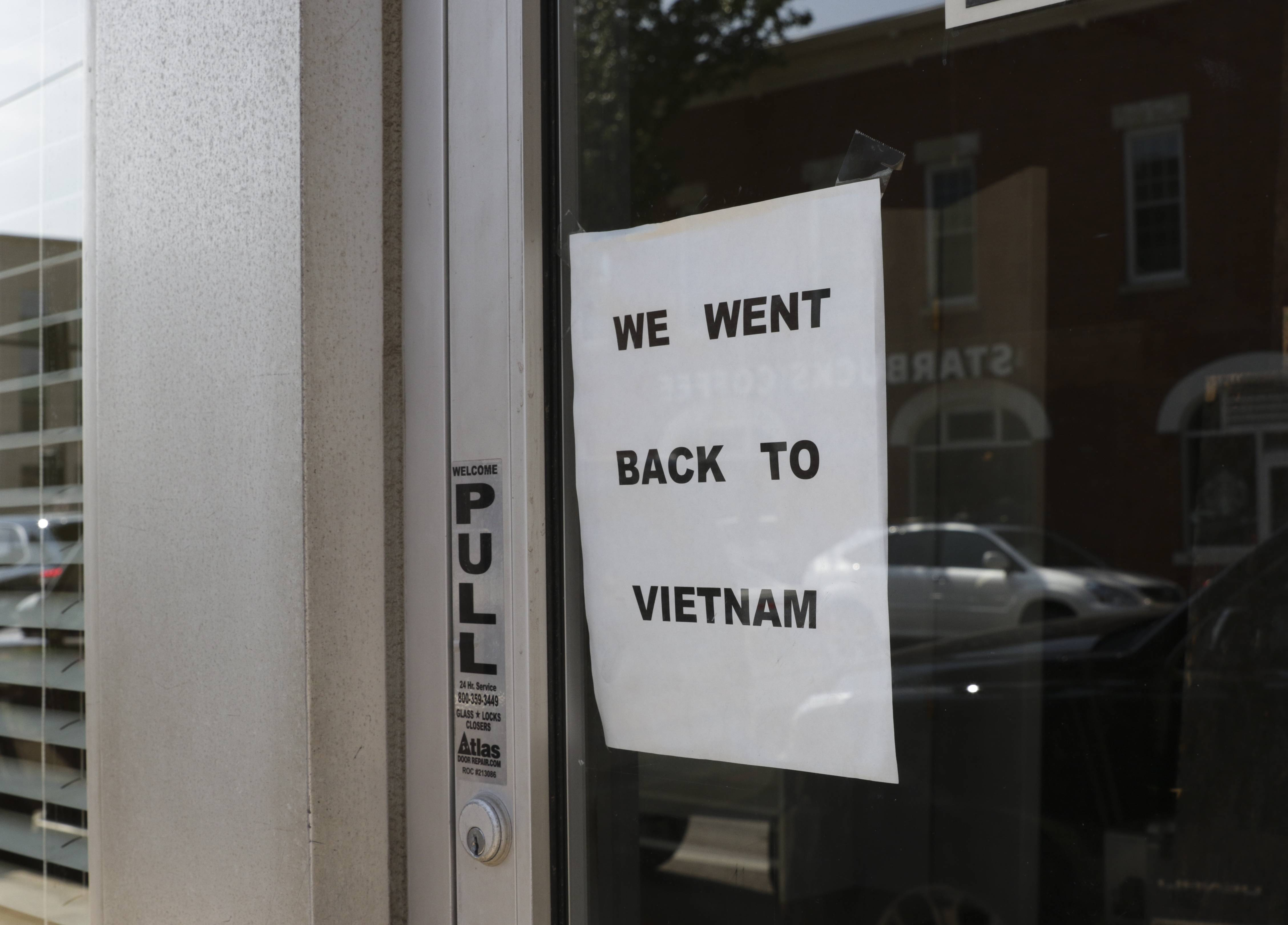Sign in window of former Luong-Loi restaurant in downtown Wheaton. The restaurant moved to another location across the street.