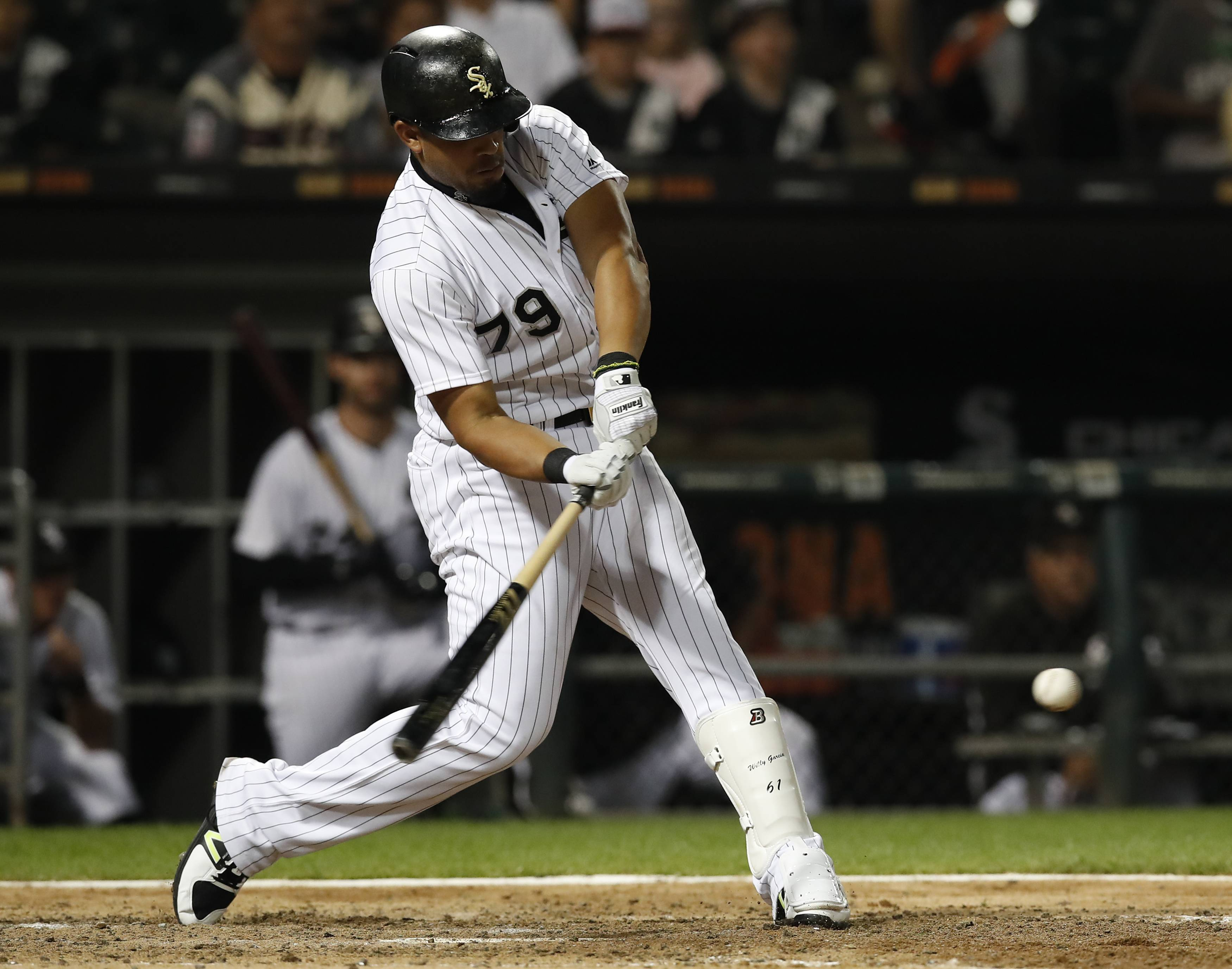 Chicago White Sox's Jose Abreu hits his 100th RBI of the season during the seventh inning of a baseball game against the Kansas City Royals Saturday, Sept. 23, 2017, in Chicago. (AP Photo/Jim Young)