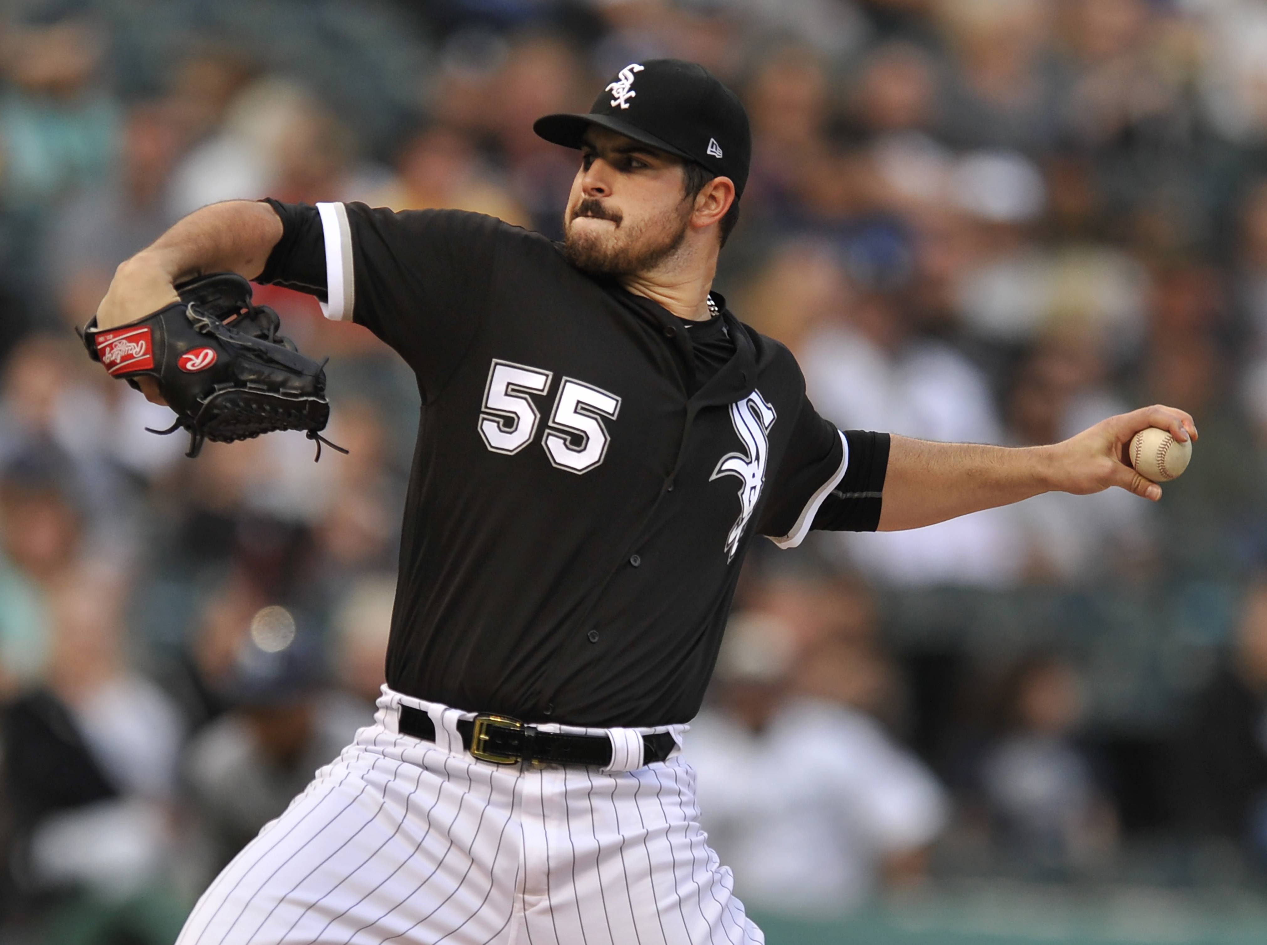 Chicago White Sox starter Carlos Rodon delivers a pitch during the first inning of a baseball game against the Tampa Bay Rays, Saturday, Sept. 2, 2017, in Chicago. (AP Photo/Paul Beaty)