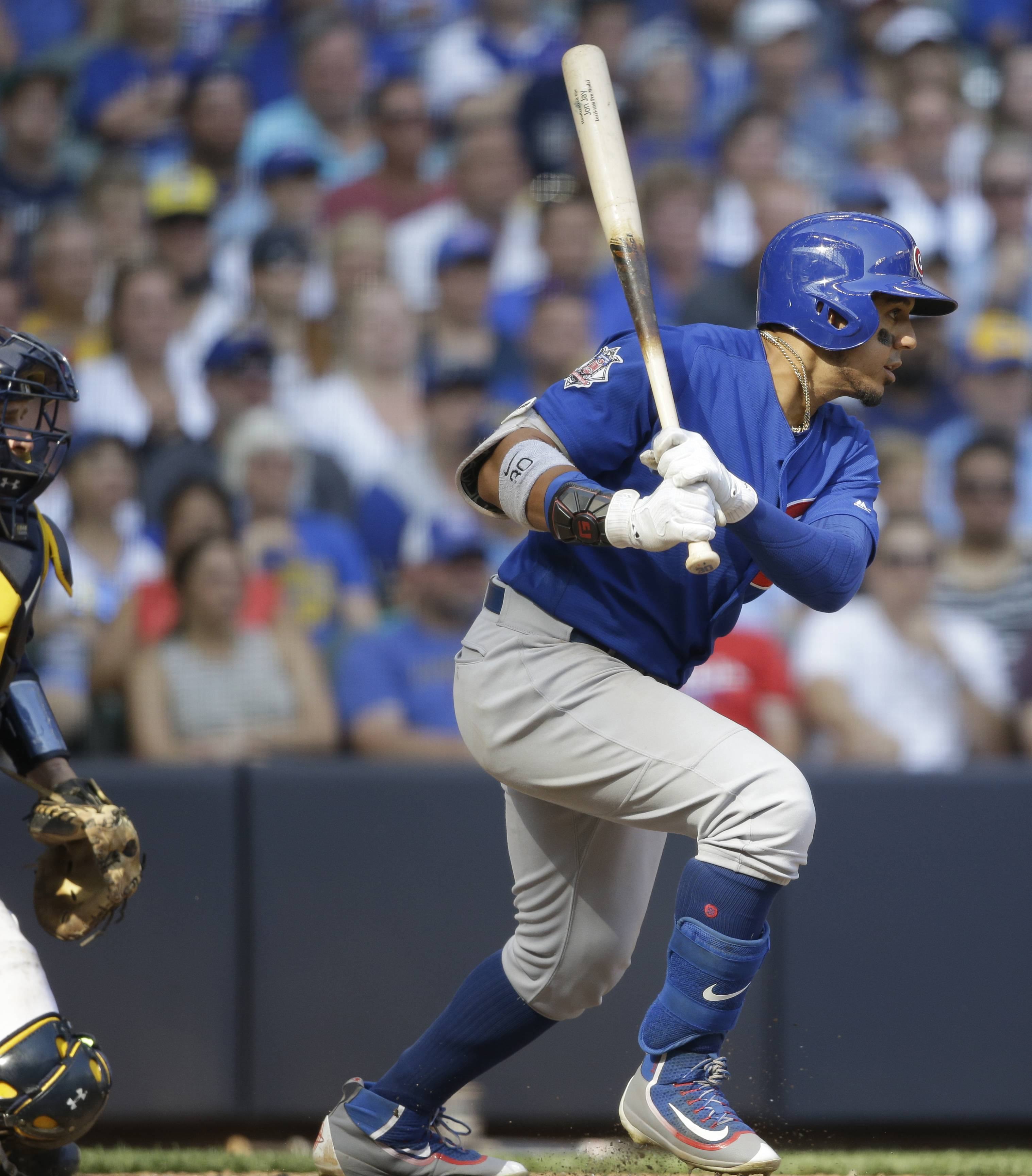 Chicago Cubs' Jon Jay watches his RBI single against the Milwaukee Brewers during the 10th inning of a baseball game Saturday, Sept. 23, 2017, in Milwaukee.