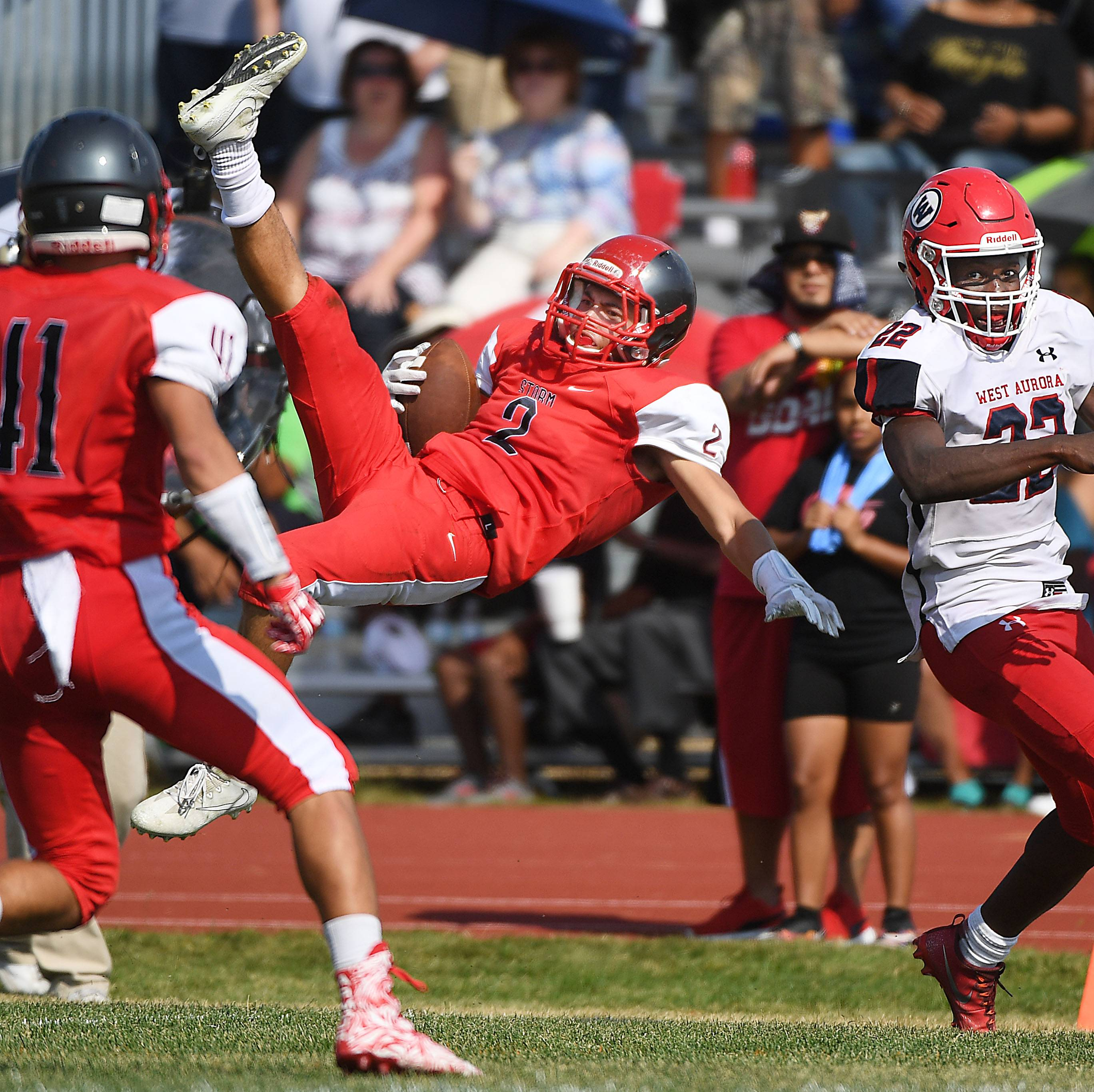South Elgin's Azxavier Salinas comes down on his back out-of-bounds as he intercepts a West Aurora pass intended for Hezekiah Salter Saturday in South Elgin.