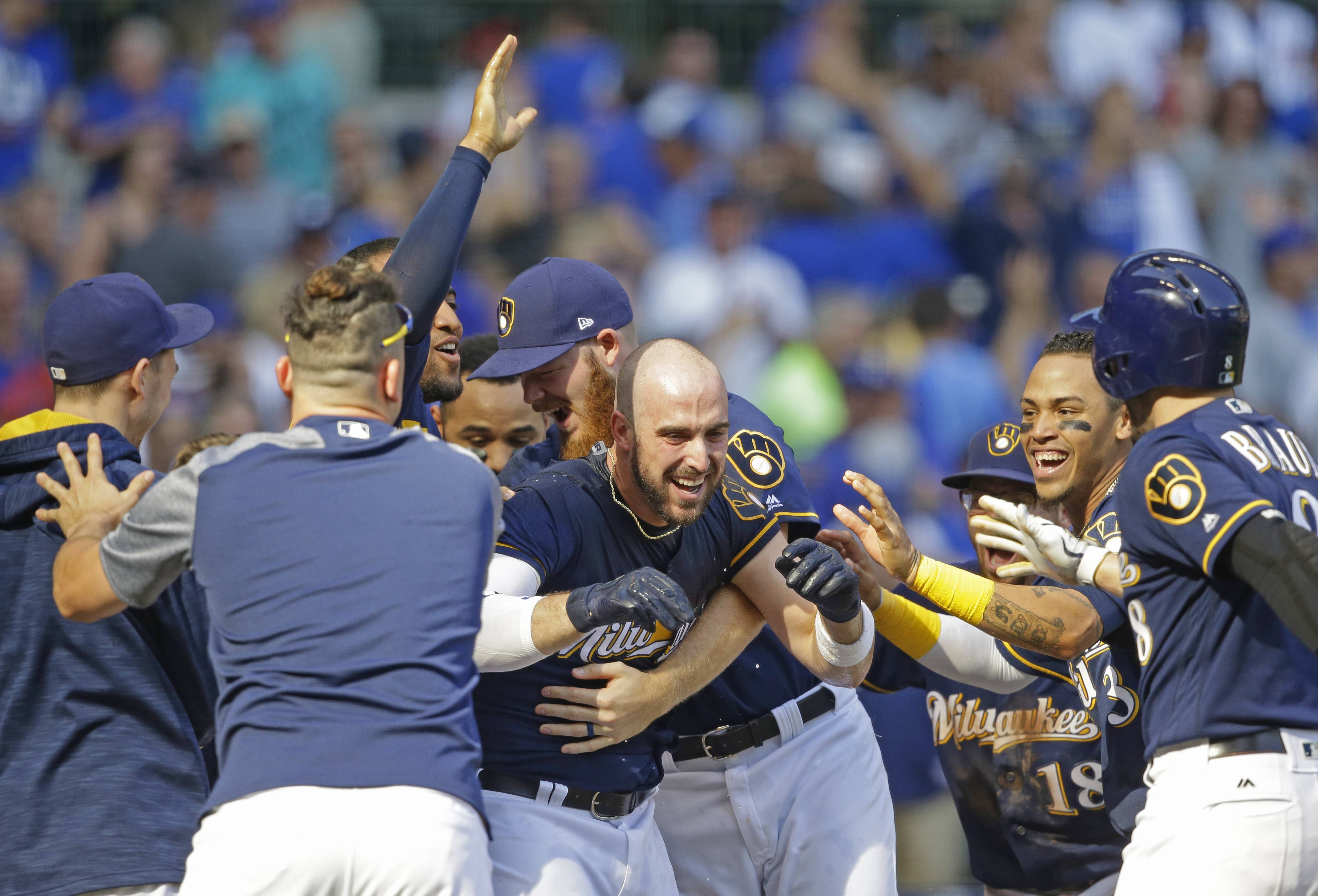 Milwaukee Brewers' Travis Shaw, center, is congratulated by teammates after a two-run game winning home run against the Chicago Cubs in the 10th inning Saturday, Sept. 23, 2017, in Milwaukee. The Brewers won 4-3 in 10 innings.