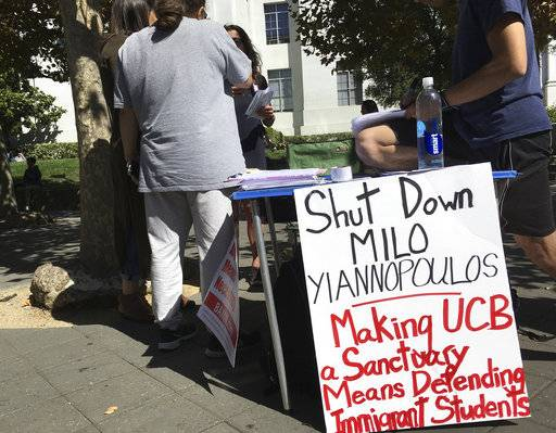 "CORRECTS TO OMIT ANN COULTER- -In this Sept. 21, 2017 photo, a group has put up flyers and a booth on Sproul Plaza calling for protesters to ""Shut Down Milo Yiannopoulos,"" at the University of California, Berkeley campus in Berkeley, Calif. Right-wing showman Milo Yiannopoulos is holding a ""Free Speech Week"" at the University of California, Berkeley with a planned lineup including conservative firebrands Steve Bannon. The university says it has no confirmation the headline acts will appear but is preparing strong security to head off any more violent protests at the liberal campus. (AP Photo/Jocelyn Gecker)"