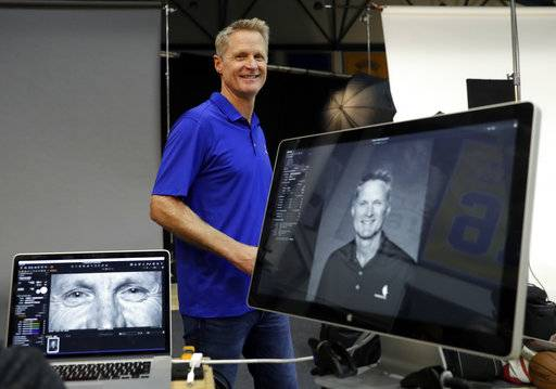 Golden State Warriors head coach Steve Kerr smiles after posing for photographs during NBA basketball team media day Friday, Sept. 22, 2017, in Oakland , Calif.