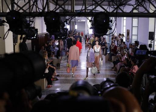Models wear creations as part of the Bottega Veneta women's Spring/Summer 2018 fashion collection, presented in Milan, Italy, Saturday, Sept. 23, 2017. (AP Photo/Luca Bruno)