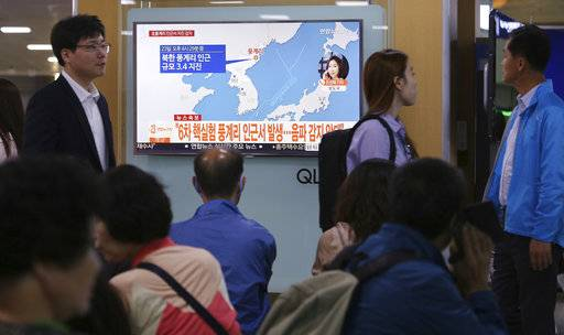 "People watch a TV news program reporting North Korea's earthquake, at Seoul Railway Station in Seoul, South Korea, Saturday, Sept. 23, 2017. South Korea's weather agency said an earthquake was detected in North Korea on Saturday around where the country recently conducted a nuclear test, but it assessed the quake as natural. The signs read "" The quake was detected in an area around Punggye-ri where the North conducted its sixth and most powerful nuclear test."""