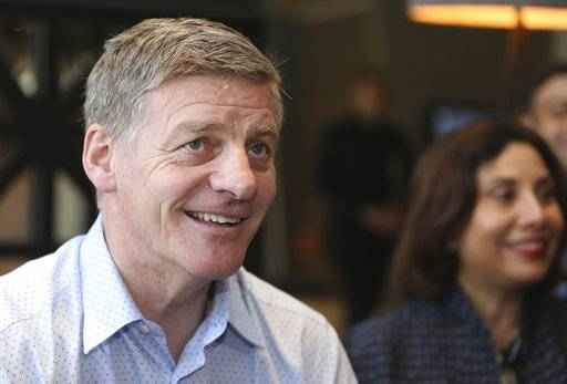 New Zealand Prime Minister Bill English talks to the media at his hotel in Auckland, New Zealand, Saturday, Sept. 23, 2017. New Zealanders were voting Saturday in a national election that appears to be a close race between conservative English and liberal challenger Jacinda Ardern. (Doug Sherring/New Zealand Herald via)
