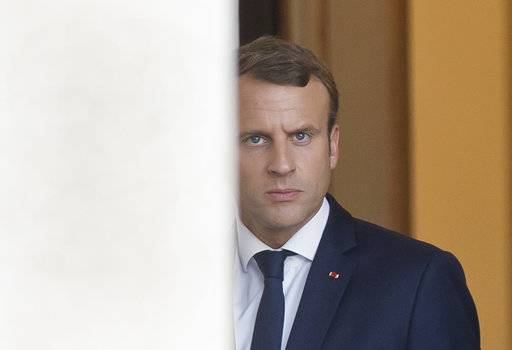 French President French President Emmanuel Macron walks out of the Elysee Palace as he awaits European Parliament President Antonio Tajani in Paris, France, Friday, Sept. 22, 2017.