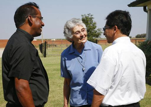 Sister Marita Rother, center, talks with Fr. John Peter Swaminathan, left, current pastor of Holy Trinity Catholic Church, and a visitor from the Guatemalan delegation, right, in the yard of the Rother Family home in Okarche, Okla, Thursday, Sept. 21, 2017. A ceremony for Marita's brother Stanley Rother's Beatification is scheduled for Saturday, Sept. 23, 2017.