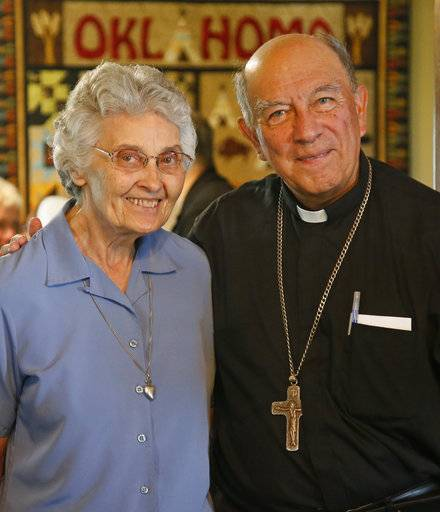 Sister Marita Rother, left, and Guatemalan Bishop Julio Edgar Cabrera, right, pose for a photo in the Rother Family home in Okarche, Okla, Thursday, Sept. 21, 2017. Sister Marita, born Elizabeth Mary Rother, is the sister of Stanley Rother, an American priest killed during Guatemala's civil war, who is on the path to possible sainthood. A ceremony for Rother's Beatification is scheduled for Saturday, Sept. 23, 2017.