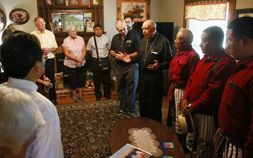 Guatemalan Bishop Julio Edgar Cabrera, center, leads a prayer in the Rother Family home in Okarche, Okla, Thursday, Sept. 21, 2017. Father Stanley Rother was an American priest killed during Guatemala's civil war, who is on the path to possible sainthood. A ceremony for Rother's Beatification is scheduled for Saturday, Sept. 23, 2017.