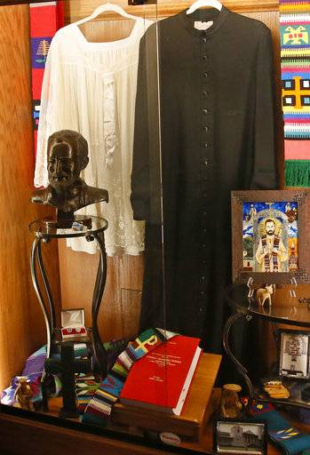 A tribute to Father Stanley Rother is displayed inside Holy Trinity Catholic Church in Okarche, Okla, Thursday, Sept. 21, 2017. Holy Trinity was the childhood church of Stanley Rother, an American priest killed during Guatemala's civil war, who is on the path to possible sainthood. A ceremony for Rother's Beatification is scheduled for Saturday, Sept. 23, 2017.