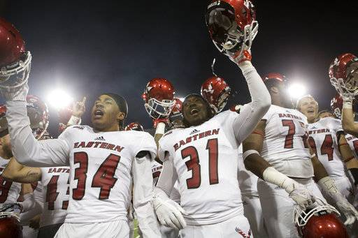 Eastern Washington players sing the fight song to their fans after playing Montana in an NCAA college football game Saturday, Sept. 23, 2017, in Missoula, Mont. Eastern Washington won 48-41.
