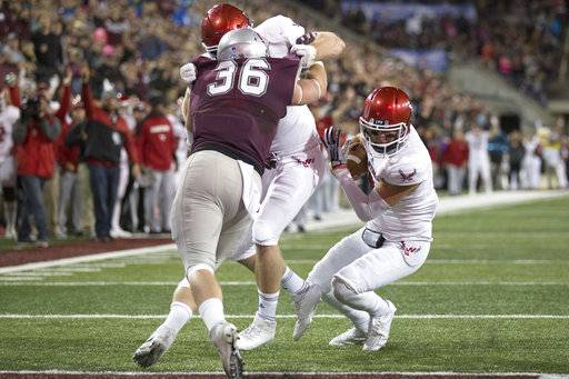 Eastern Washington quarterback Gage Gubrud, right, rushes for a touchdown against Montana during an NCAA college football game Saturday, Sept. 23, 2017, in Missoula, Mont. Eastern Washington won 48-41.