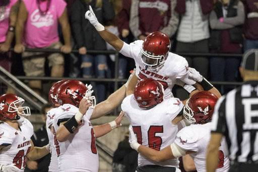 Eastern Washington running back Antoine Custer Jr. (28) is lifted by his teammates after scoring a touchdown against Montana in an NCAA college football game Saturday, Sept. 23, 2017, in Missoula, Mont. Eastern Washington won 48-41.