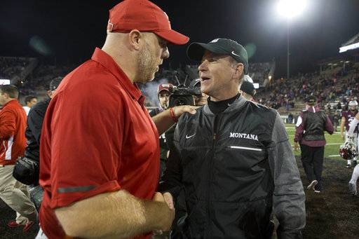 Montana coach Bob Stitt, right, shakes hands with Eastern Washington coach Aaron Best after an NCAA college football game Saturday, Sept. 23, 2017, in Missoula, Mont. Eastern Washington won 48-41.