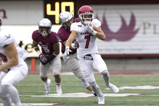 Eastern Washington wide receiver Nic Sblendorio (7) is chased down and tackled by Montana linebacker Josh Buss (42) in the first quarter of an NCAA college football game Saturday, Sept. 23, 2017, in Missoula, Mont.