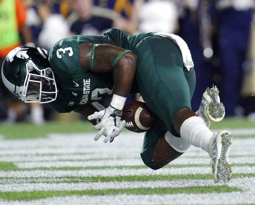 Michigan State's LJ Scott tries unsuccessfully to recover his fumble in the end zone during the second quarter against Notre Dame in an NCAA college football game, Saturday, Sept. 23, 2017, in East Lansing, Mich. The ball was recovered by Notre Dame.