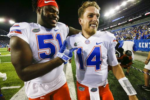 Florida offensive lineman Antonio Riles, left, celebrates with quarterback Luke Del Rio after an NCAA college football game against Kentucky, Saturday, Sept. 23, 2017, in Lexington, Ky. (AP Photo/David Stephenson)