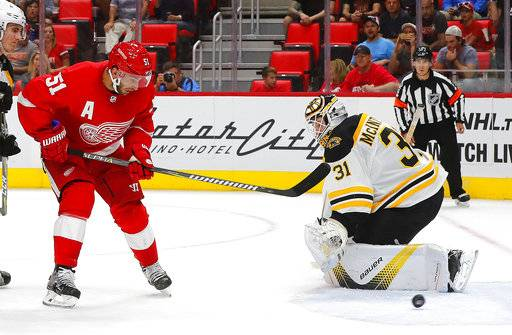 Detroit Red Wings center Frans Nielsen (51) scores against Boston Bruins goalie Zane McIntyre (31) in the second period of an NHL preseason hockey game, Saturday, Sept. 23, 2017, in Detroit. (AP Photo/Paul Sancya)