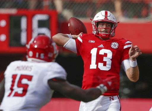 Nebraska quarterback Tanner Lee (13) throws as Rutgers linebacker Trevor Morris (15) closes in, during the first half of an NCAA college football game in Lincoln, Neb., Saturday, Sept. 23, 2017. (AP Photo/Nati Harnik)