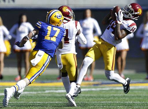Southern California's Ykili Ross, right, intercepts a pass intended for California's Vic Wharton III during the second half of an NCAA college football game Saturday, Sept. 23, 2017, in Berkeley, Calif. (AP Photo/Ben Margot)