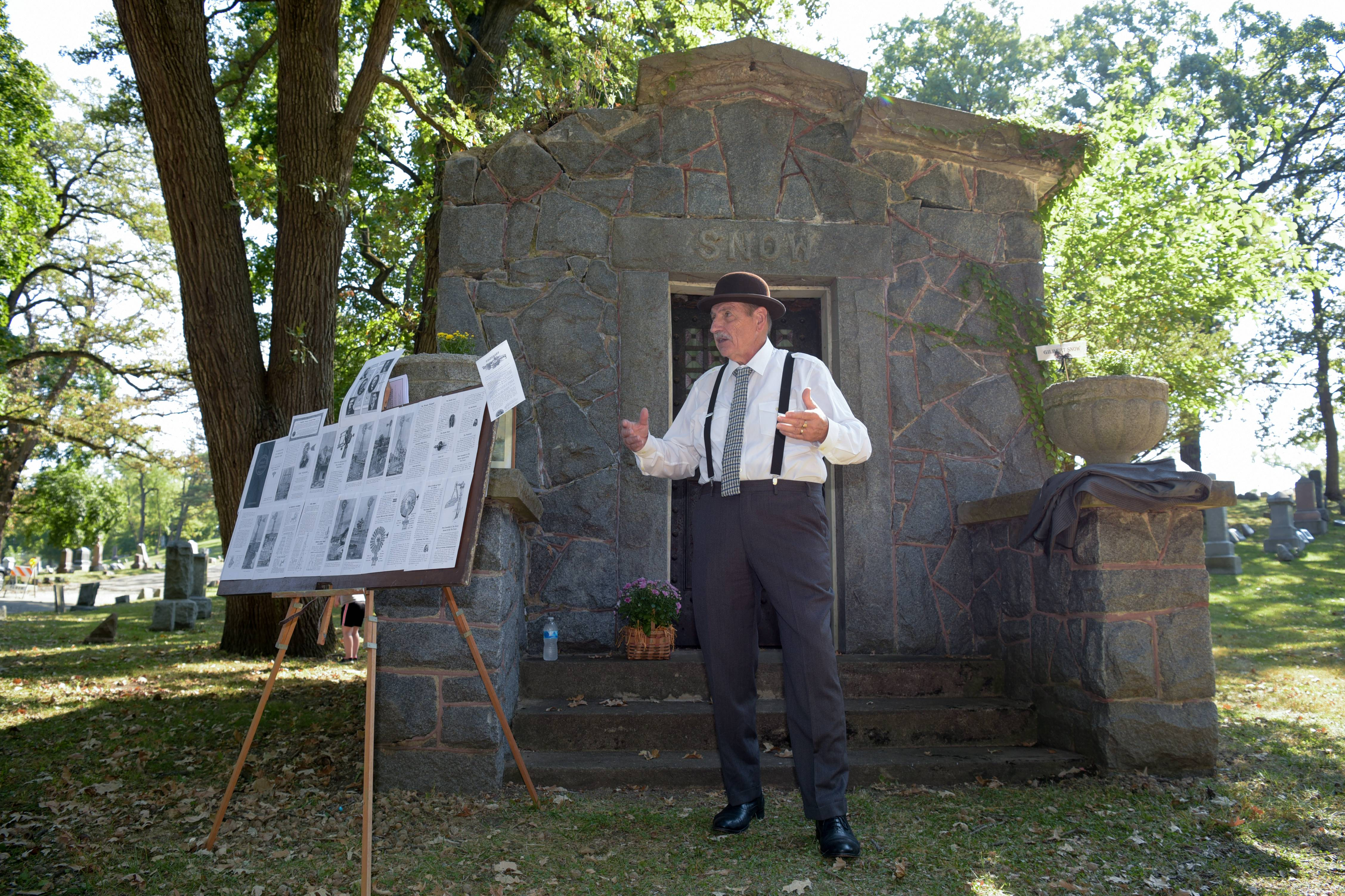 August Conte portrays Gilbert B. Snow, who invented the self-oiling windmill for the Elgin Wind Power and Pump Company, during the annual Elgin Cemetery Walk at Bluff City Cemetery Sunday.