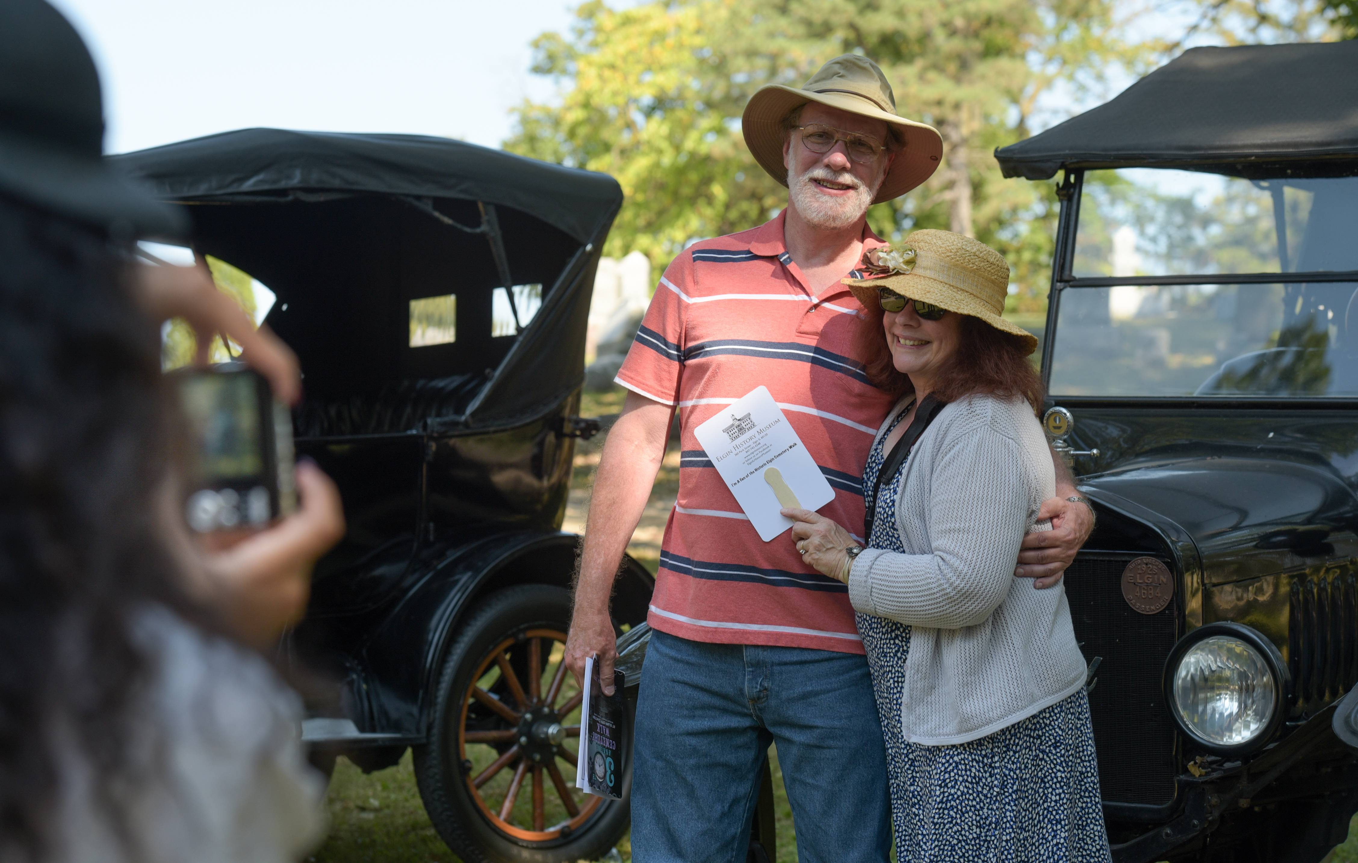 Dave Carlson and Mary Hogan of Elgin pose for a photo Sunday in front of a 1923 Ford Model T during the annual Elgin Cemetery Walk at Bluff City Cemetery.