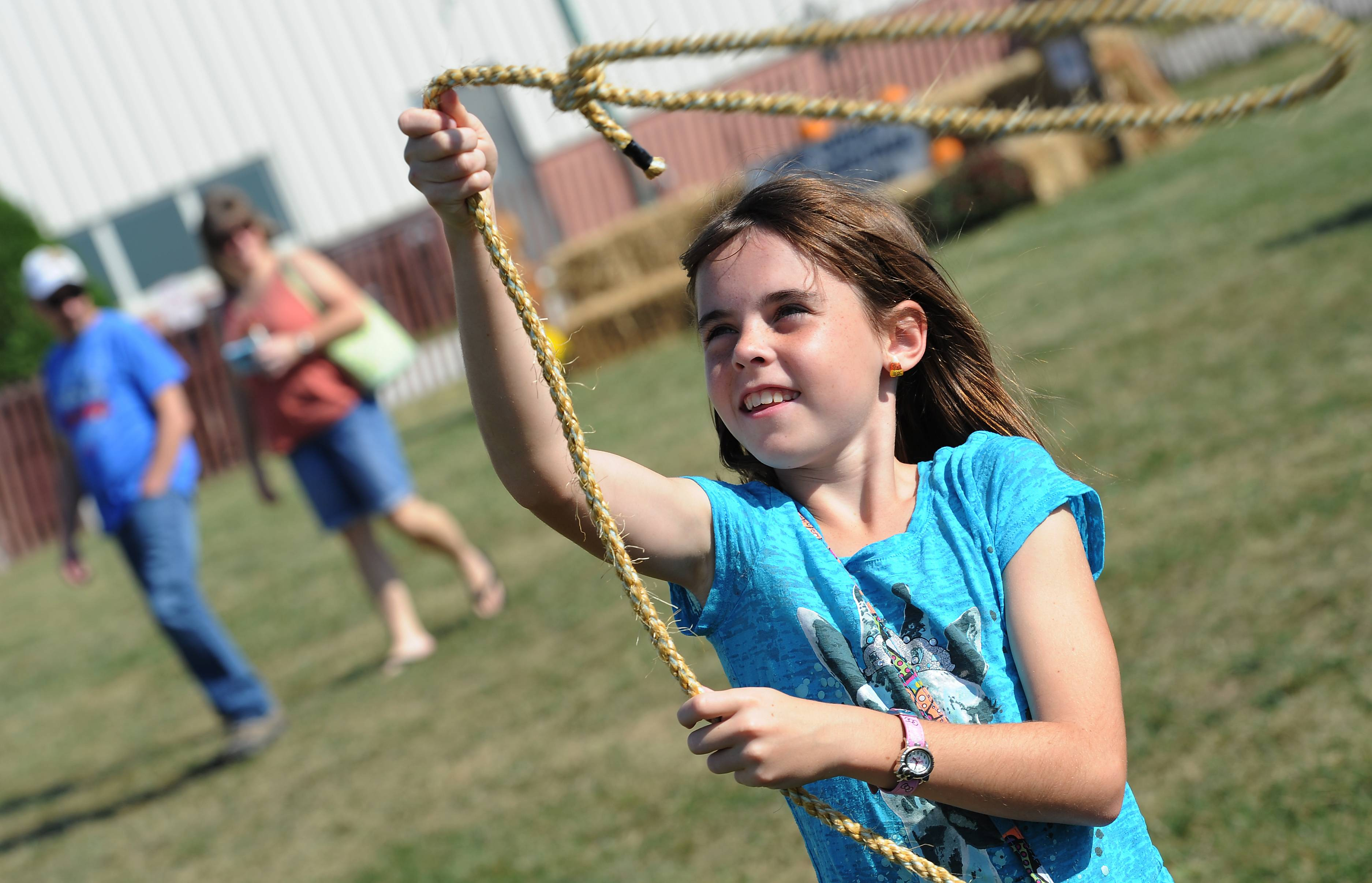 Tylea Crow, 10, practices her roping skills at the Farm Heritage and Harvest Festival at the Lake County Fairgrounds on Sunday.