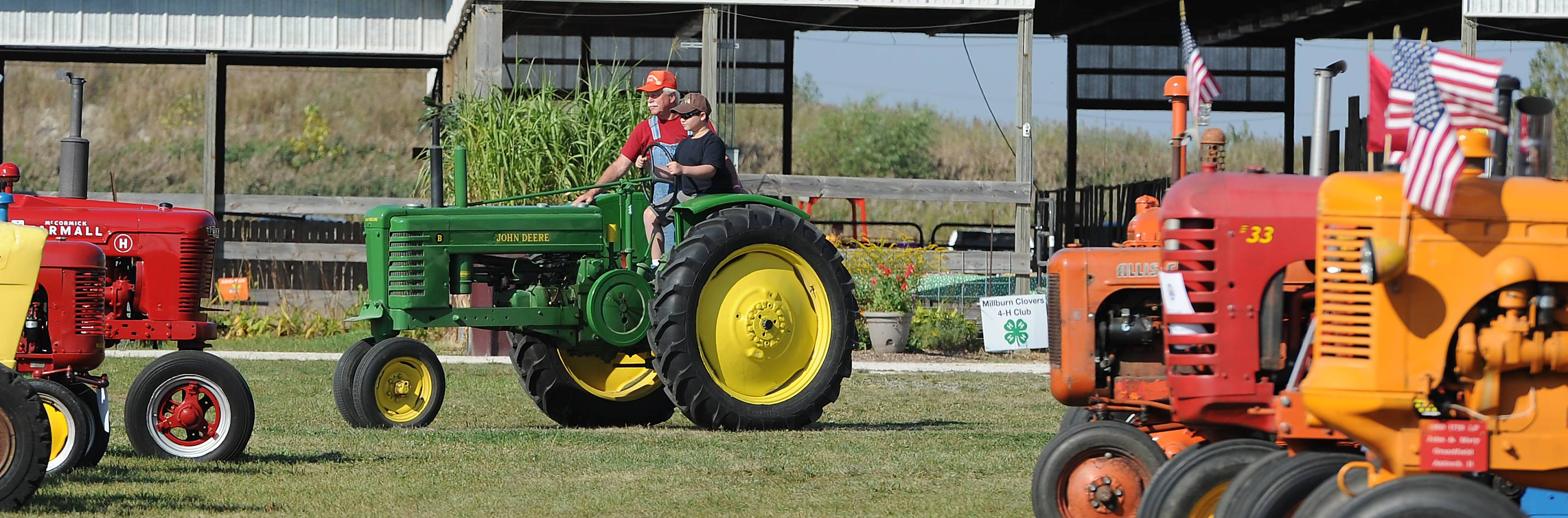 Bryan Dussault, 11, of Winthrop Harbor drives the 1941 John Deere tractor under the guidance of Don Schreiber of Gurnee at the Farm Heritage and Harvest Festival at the Lake County Fairgrounds on Sunday.
