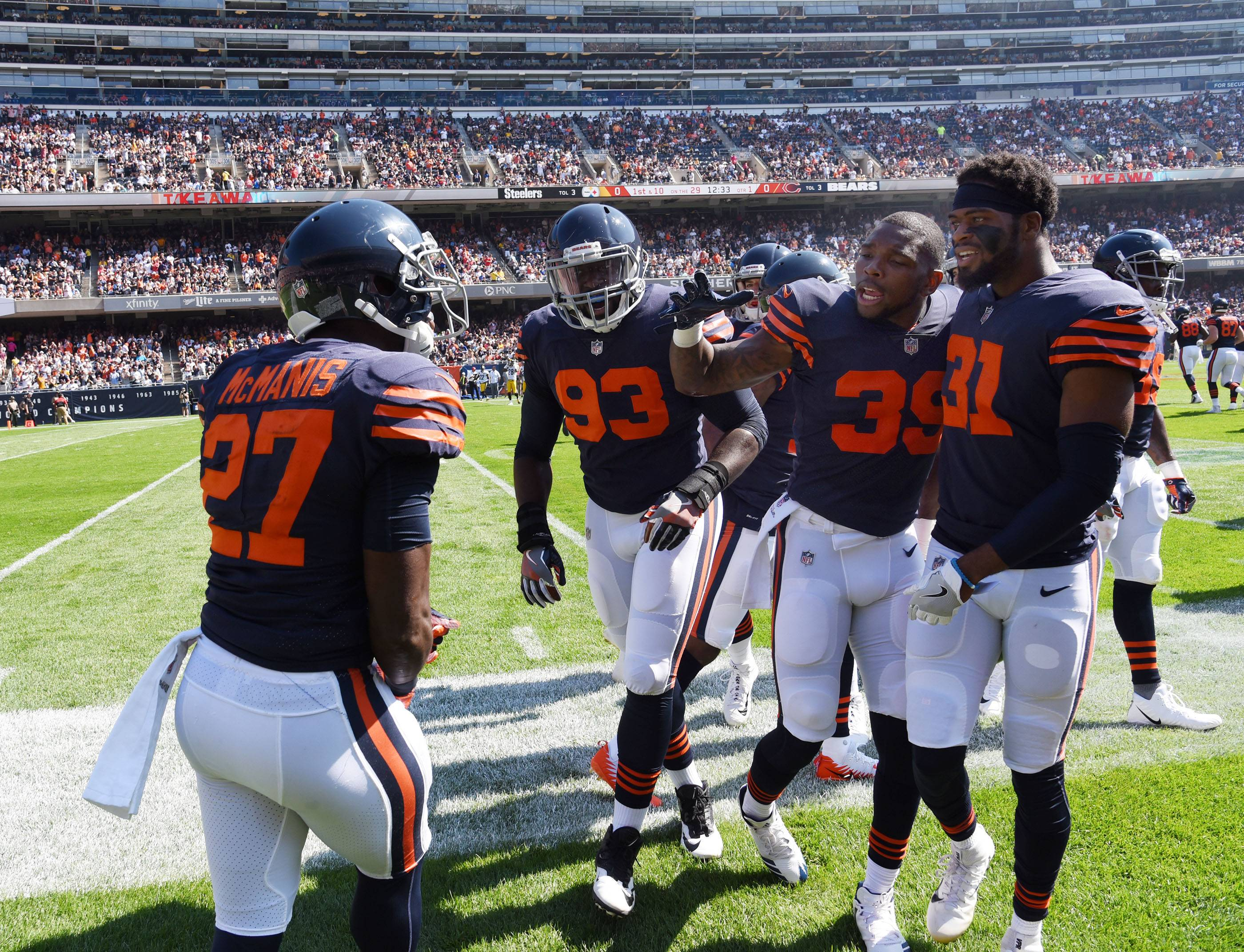 Chicago Bears teammates come to congratulate cornerback Sherrick McManis on his fumble recovery on a kickoff early in the game Sunday at Soldier Field in Chicago. The turnover resulted in a Chicago touchdown.