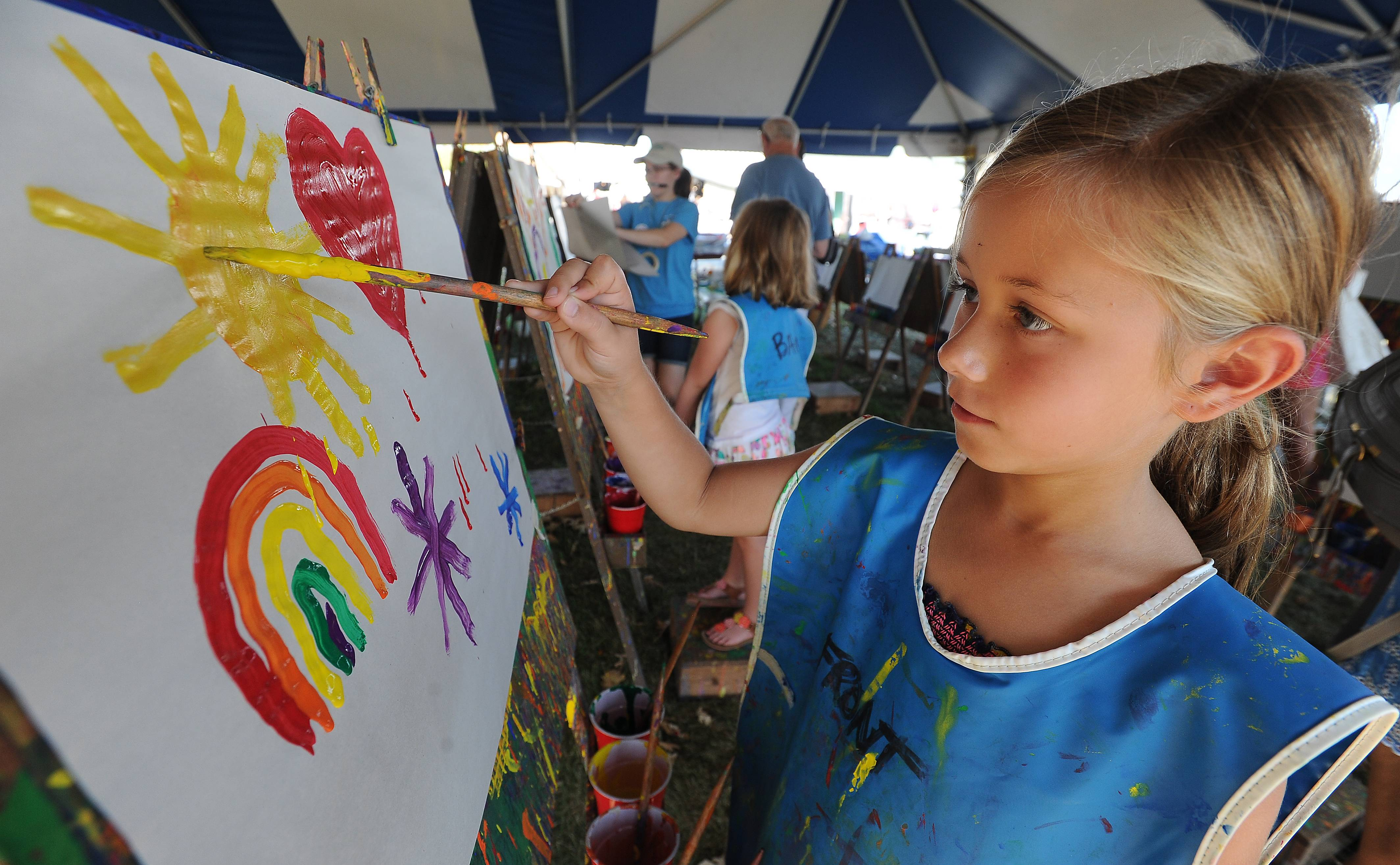 Eleanor Jankowski, 7, of Barrington displays her flair for color at the Art in the Barn festival on Advocate Good Shepherd Hospital grounds in Barrington on Sunday.