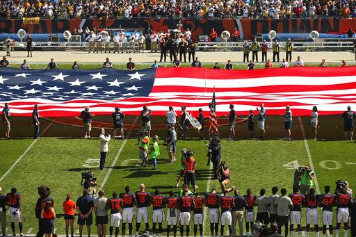 The Pittsburgh Steelers side of the field is nearly empty during the playing of the national anthem before an NFL football game between the Steelers and Chicago Bears, Sunday, Sept. 24, 2017, in Chicago. The Pittsburgh Steelers players did not come out to the field during the anthem.