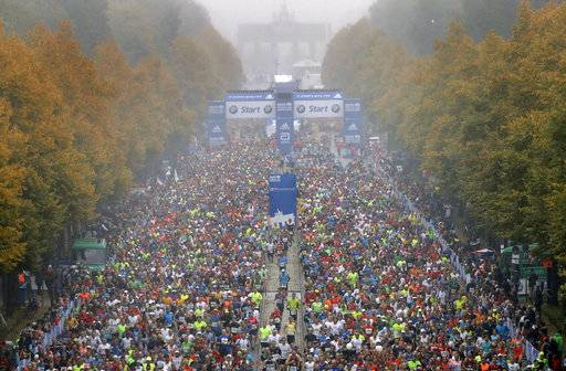 Runners start the 44th Berlin Marathon in Berlin, Germany, Sunday, Sept. 24, 2017. In the background is the landmark Brandenburg Gate.