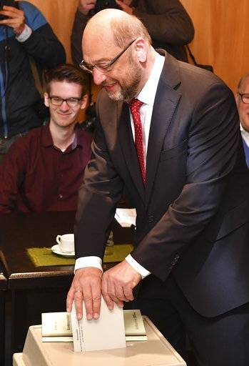 Martin Schulz, top candidate and chairman of the Social Democratic Party, casts his vote in the German parliament election in Wuerselen, Germany, Sunday, Sept. 24, 2017. Schulz is challenging Chancellor Angela Merkel who is widely expected to win a fourth term in office as Germans go to the polls.