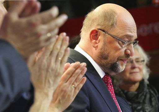 Party chairman and top candidate Martin Schulz reacts in the headquarters of the Social Democratic party in Berlin, Germany, Sunday, Sept. 24, 2017, after the polling stations for the German parliament elections had been closed. (Wolfgang Kumm/dpa via AP)