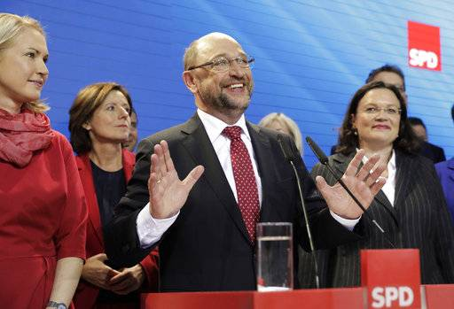 Party chairman and top candidate Martin Schulz reacts in the headquarters of the Social Democratic party in Berlin, Germany, Sunday, Sept. 24, 2017, after the polling stations for the German parliament elections had been closed.