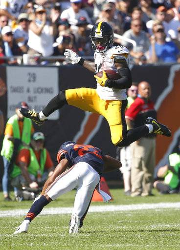 Pittsburgh Steelers running back Le'Veon Bell (26) leaps over Chicago Bears cornerback Kyle Fuller (23) during the second half of an NFL football game, Sunday, Sept. 24, 2017, in Chicago.